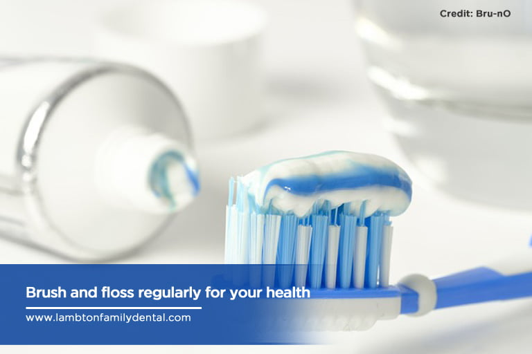 Brush and floss regularly for your health