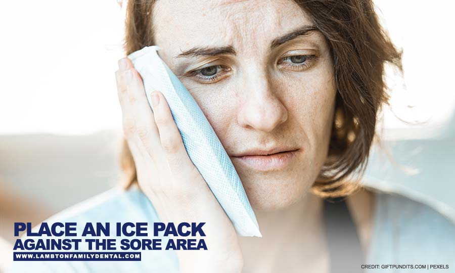 Place an ice pack against the sore area